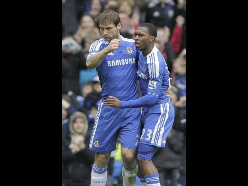 Chelsea's Daniel Sturridge (R) celebrates his goal against Birmingham City with teammate Branislav Ivanovic during their English FA Cup fifth round soccer match at Stamford Bridge, London. AP Photo/Sang Tan