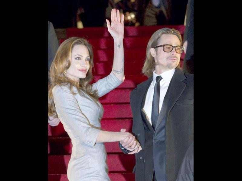 Angelina and Brad wave to fans.