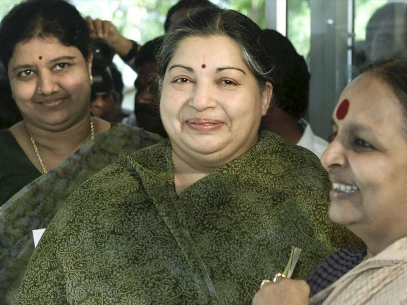 J Jayalalithaa (C) arrives with Sasikala Natarajan (L), whose husband was arrested in a land grab case, at a polling booth in Madras in this file photo. Reuters/Savita Kirloskar