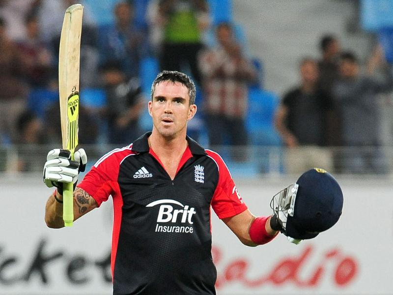 England's Kevin Pietersen raises his bat and helmet in celebration after scoring a century during the third One Day International match against Pakistan in Dubai. AFP photo/Lakruwan Wanniarachchi