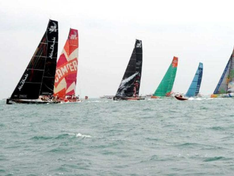 Teams start the In-Port-Race which was eventually won by Spain's Team Telefonica (R) on the eve of the Volvo Ocean Race departure from Sanya, Hainan Island. AFP Photo/Mark Ralston