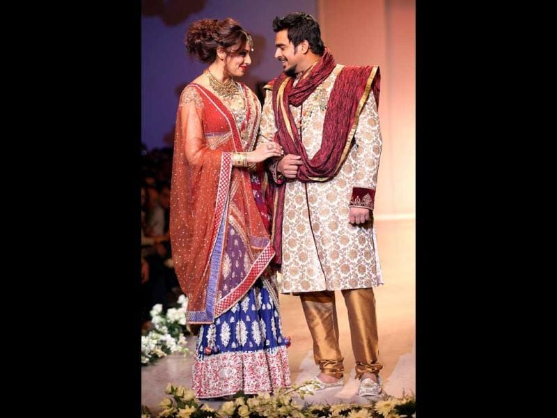 Bips looked gorgeous in a maroon and blue lehenga. Madhavan donned a golden-cream sherwani. (HT Photo/Raj K Raj)