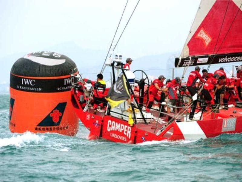 The Camper Team New Zealand yacht sails before finishing fourth during the In-Port-Race which was eventually won by Spain's Team Telefonica on the eve of the Volvo Ocean Race departure from Sanya.