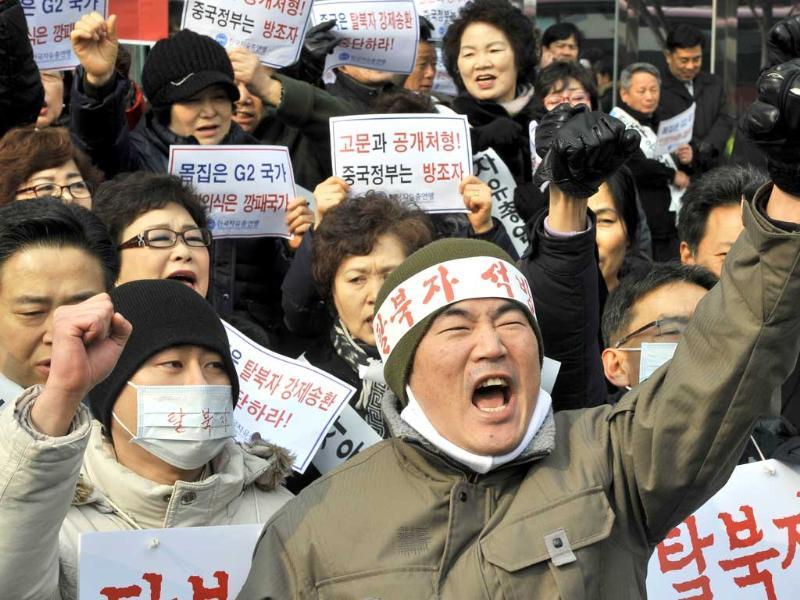 South Korean rights activists shout slogans outside the Chinese embaasy in Seoul during a rally demanding that Beijing scrap plans to repatriate arrested refugees from North Korea. AFP/Jung Yeon-Je