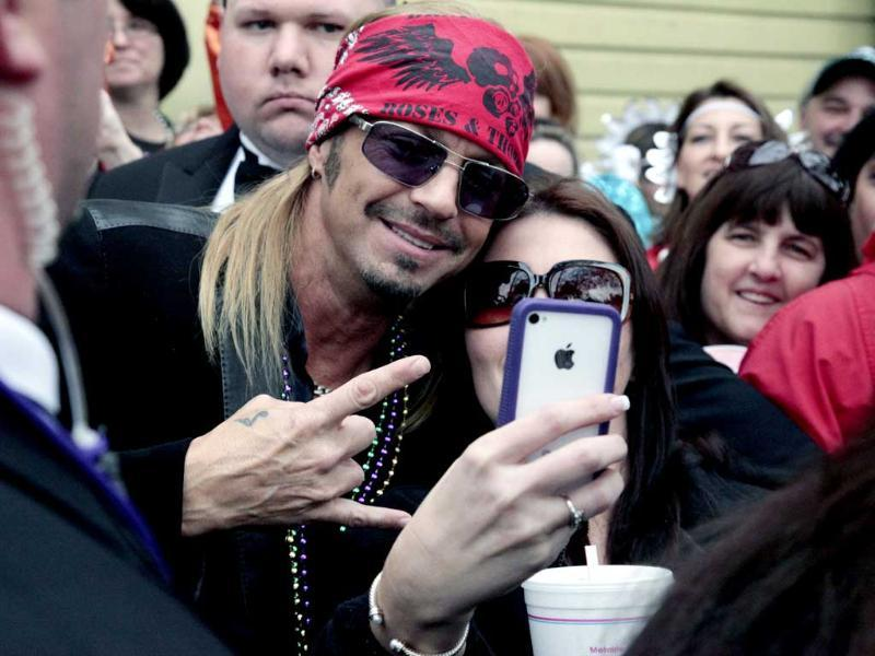 Entertainer Bret Michaels poses for a photograph with a fan as he arrives at the staging area for the start of the Mardi Gras parade in New Orleans. AP/Bill Haber
