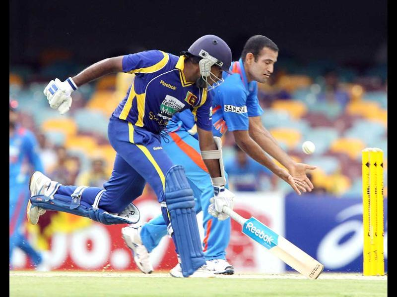 Mahela Jayawardena, left, clashes with Irfan Pathan, in an attempted run out during the One Day International cricket match between Sri Lanka and India in Brisbane. AP/Tertius Pickard