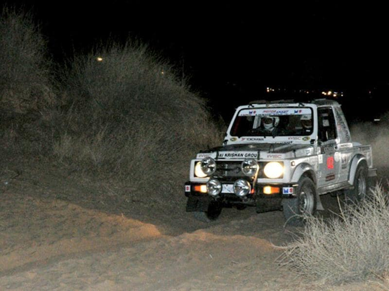 Seven-time Raid de Himalaya winner Suresh Rana drives his Gypsy at the start of the opening stage (and the only night stage) near Sardarshahar in Rajasthan. HT Photo/Vinayak Pande