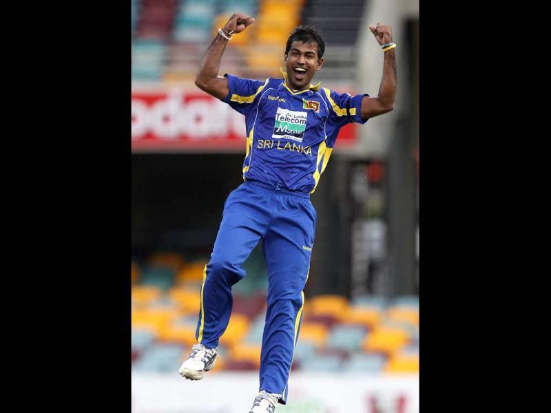 Sri Lanka's Nuwan Kulasekara celebrates after he got the wicket of Sachin Tendulkar during their One Day International cricket match in Brisbane. AP Photo/Tertius Pickard