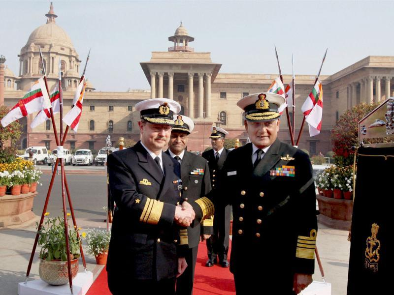 Chief of Staff of German Navy, Vice Admiral Axel Schimpf is welcomed by Chief of Naval Staff Admiral Nirmal Verma at South Block in New Delhi. PTI/Atul Yadav