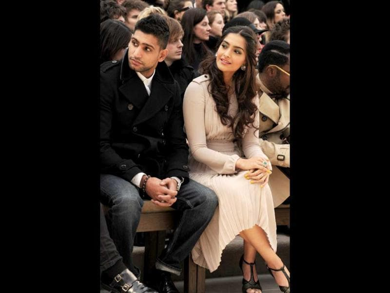 Sonam Kapoor with boxer Amir Khan at Burberry Prorsum Autumn Winter 2012 Womenswear Show.