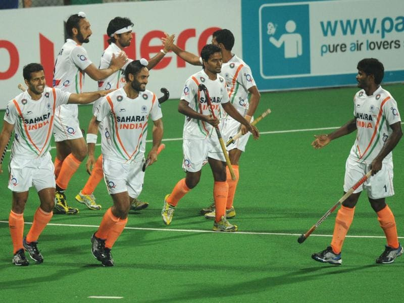 Indian players celebrate a goal during the men's field hockey match against France of the FIH London 2012 Olympic Hockey qualifying tournament at the Major Dhyan Chand National Stadium in New Delhi. AFP photo/Indranil Mukherjee