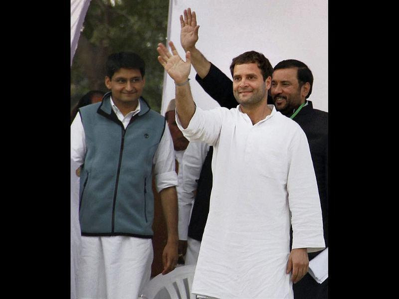 Congress general secretary Rahul Gandhi waves to supporters at an election rally in Mawana, Meerut. PTI Photo