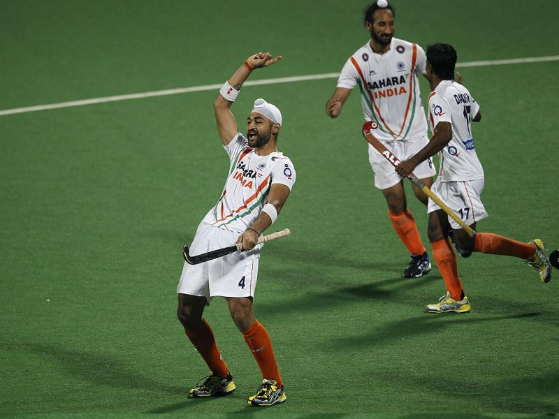 Sandeep Singh, left, reacts after scoring India's fifth goal, as teammates Sardar Singh, second left, and Danish Mujtaba, right, celebrate during their field hockey Olympic qualifier against France in New Delhi.(AP Photo)