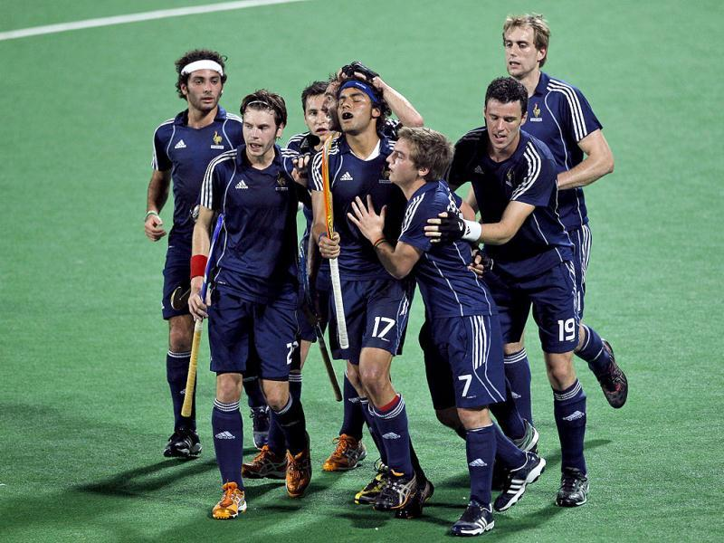French players celebrate after scoring a goal against India during their field hockey Olympic qualifier in New Delhi. (AP Photo)