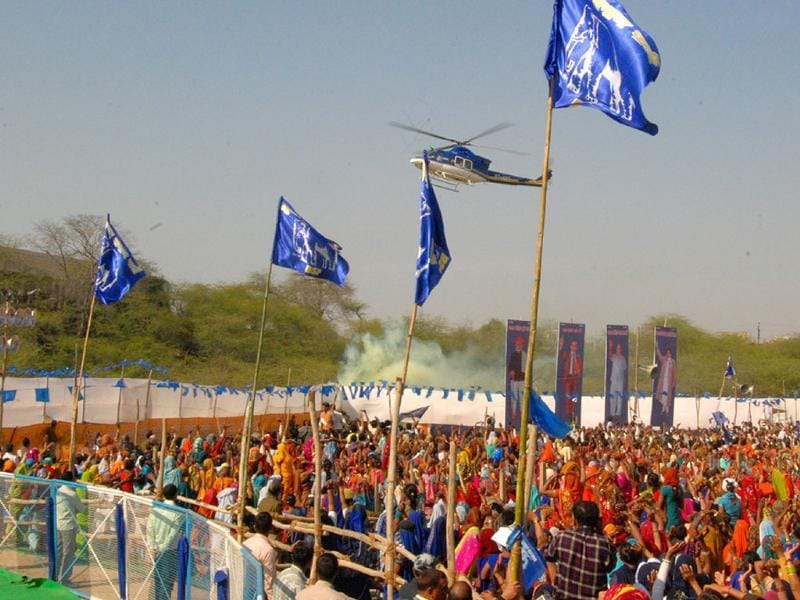 Supporters wave at Mayawati's helicopter during a BSP rally in Agra. HT/Avinash Jaiswal