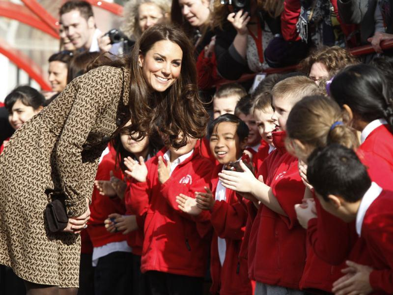 The Duchess of Cambridge meets with children as she leaves Rose Hill Primary School in Oxford, England. (AP Photo/Lefteris Pitarakis)