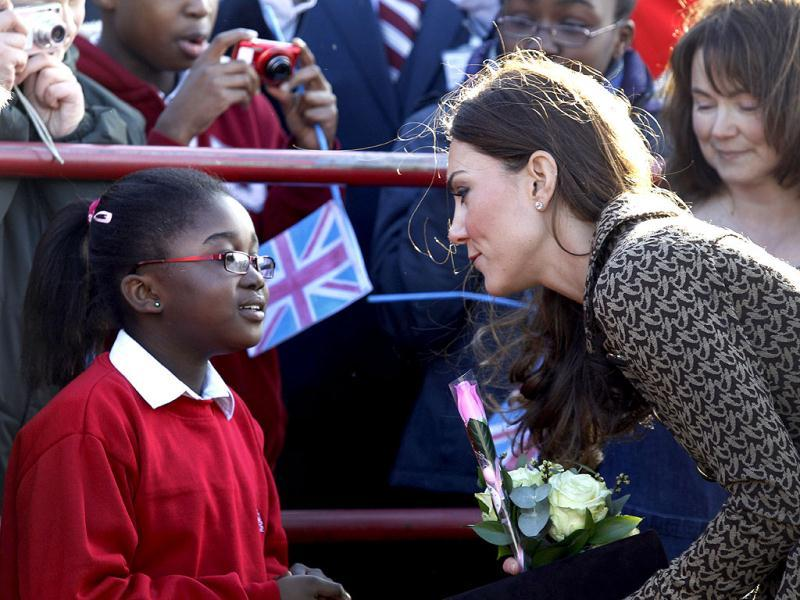 The Duchess of Cambridge talks to children as she arrives at Rose Hill Primary School in Oxford, England. (AP Photo/Lefteris Pitarakis)