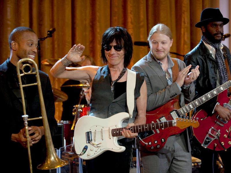 Troy Trombone Shorty Andrews (L), Guitarists Jeff Beck (2nd L), Derek Trucks (2nd R) and Gary Clark (R) play during a celebration of Blues music and in recognition of Black History Month as part of their In Performance at the White House series in Washington, DC. AFP/Jim Watson