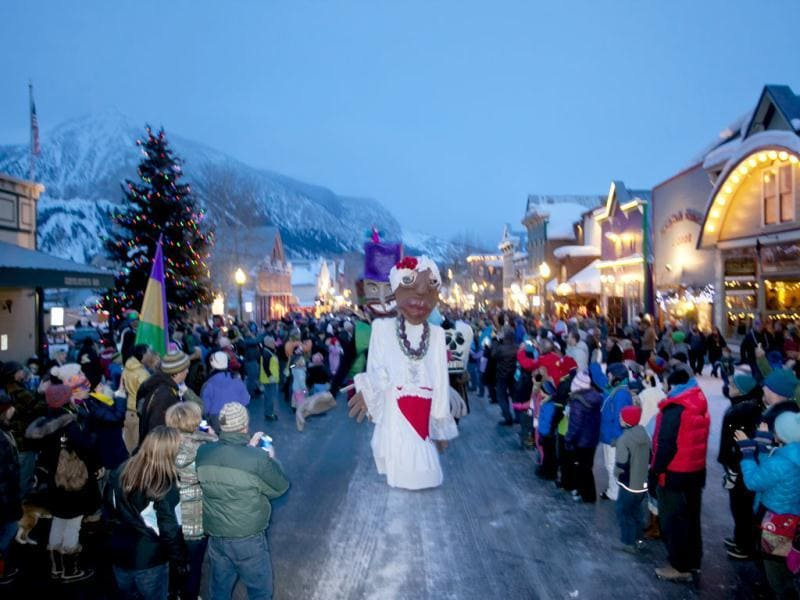 In this photo provided by Crested Butte Mountain Resort shows giant mannequins at the Mardi Gras parade in down town of Crested Butte. Hundreds of people crowded the Elk Avenue during this annual event. AP/Nathan Bilow