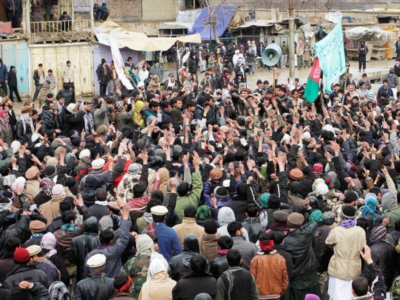 Afghan protestors shout slogans in front of the US base of Bagram during an anti US demonstration in Bagram north of Kabul, Afghanistan. AP/Musadeq Sadeq