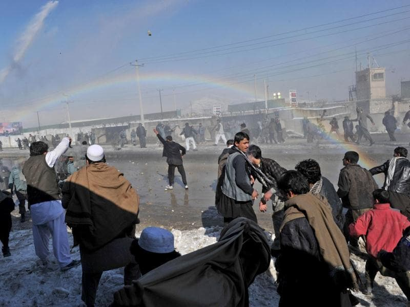 Afghan demonstrators clash with policemen during a protest against Koran desecration in Kabul. AFP/Shah Marai