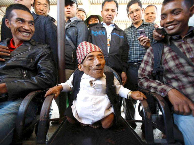Chandra Bahadur Dangi, 72, who claims to be the world's shortest man standing at a height of 22 inches (56 centimeters), speaks to the media at Tribhuvan International Airport upon his arrival from Nepalgunj, in Kathmandu. Dangi is scheduled to be verified for being the world's shortest man by the Guinness World Records on February 26. When certified by the Guinness World Records, Dangi will beat Junrey Balawing of Philippines, the current Guinness World Records holder who stands at a height of 23.5 inches (60 cm). Reuters/UNI Photo