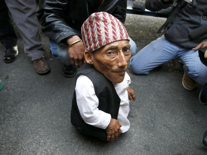 Chandra Bahadur Dangi, 72, who says he's only 22 inches (56 centimeters) tall arrives at the airport in Katmandu, Nepal. Guinness World Records officials will be in Nepal this weekend to measure Dangi who hopes to be named the world's shortest man. Dangi is hoping to snatch the title of the world's shortest man from Junrey Balawing of the Philippines, who is 23.5 inches (60 centimeters) tall. AP Photo/Binod Joshi