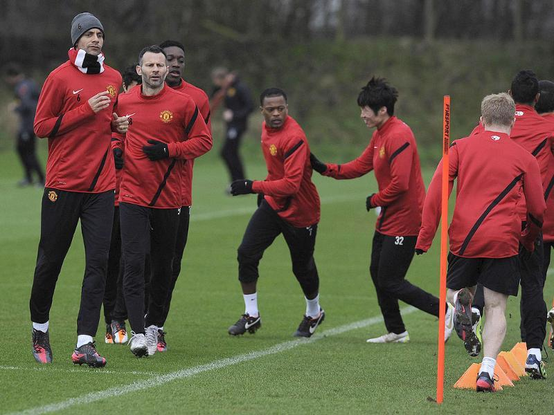 Manchester United players warm up during a training session at their Carrington training complex in Manchester. Reuters/Nigel Roddis