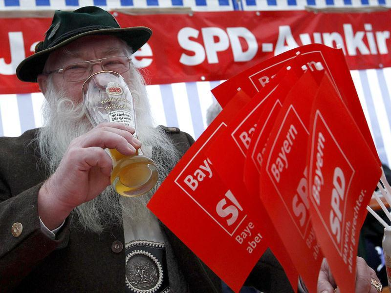 Hans Baumgartner, in traditional Bavarian clothes, drinks beer during the traditional Ash Wednesday meeting of the SPD in Vilshofen, southern Germany. (Reuters/Michaela Rehle)