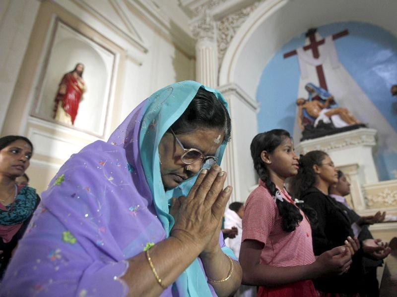 A woman, her forehead marked with ash in the symbol of the crucifix, attends a mass in observance of Ash Wednesday at a Catholic church in Hyderabad. (AP Photo/Mahesh Kumar A.)