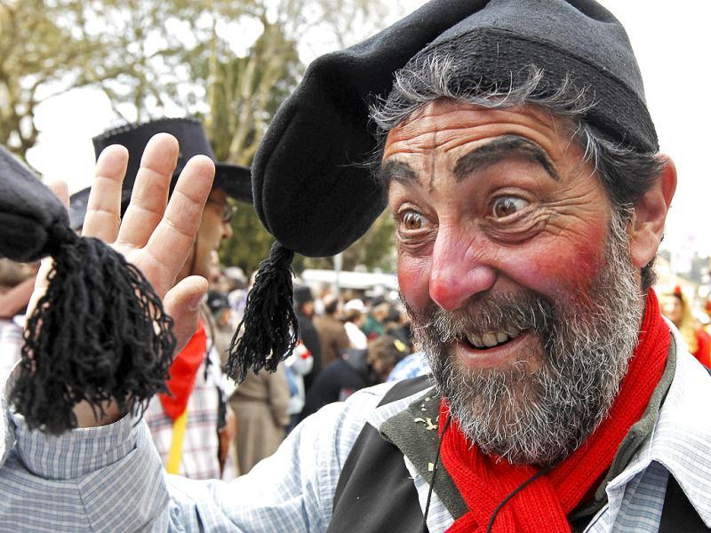A carnival reveller participates in the Torres Vedras parade. The Portuguese have mostly quietly accepted reforms in the labour market, soaring unemployment and cuts to welfare to rein in their debt mountain - but calls to cancel the centuries-old tradition of carnival went a step too far. The government tried, in the name of austerity imposed by international lenders, to force the end of Tuesday's public holiday but the country effectively shut down all the same as the Portuguese refused to go without their pre-Lent festival. REUTERS/Jose Manuel Ribeiro