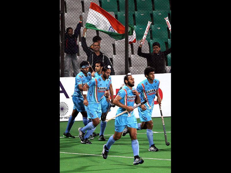 Shivendra Singh celebrates with his teammates after scoring a goal against Canada during their Olympic qualifier match, in New Delhi. PTI Photo by Manvender Vashist