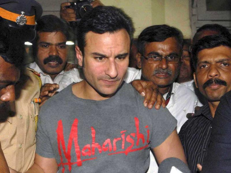 Bollywood actor Saif Ali Khan who's been charged with assaulting two fellow diners at Mumbai's Taj Mahal Palace hoteli s escorted by the police at a police station in Mumbai. (Reuters)