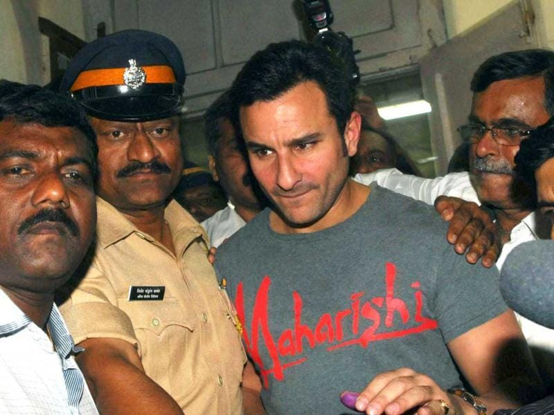 Bollywood star Saif Ali Khan, surrounded by police officials, leaves a police station in Mumbai. (AFP)