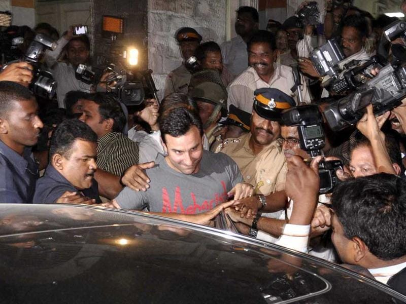 Bollywood actors Saif Ali Khan, center, is surrounded by the media as he comes out of a police station in Mumbai. (AP)