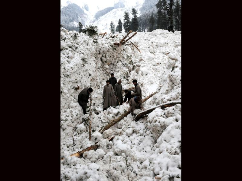 Kashmiri villagers search for their belongings after their huts were buried under snow due to avalanche at Ramwari some 70 km from summer capital Srinagar. At least nine Indian soldiers on duty in the mountains of Kashmir were killed in avalanches overnight with several others missing, officials said. Two avalanches swept through army camps in Dawar and Sonamarg, both near the heavily-militarised Line of Control that divides Kashmir between India and Pakistan. AFP Photo/Rouf Bhat