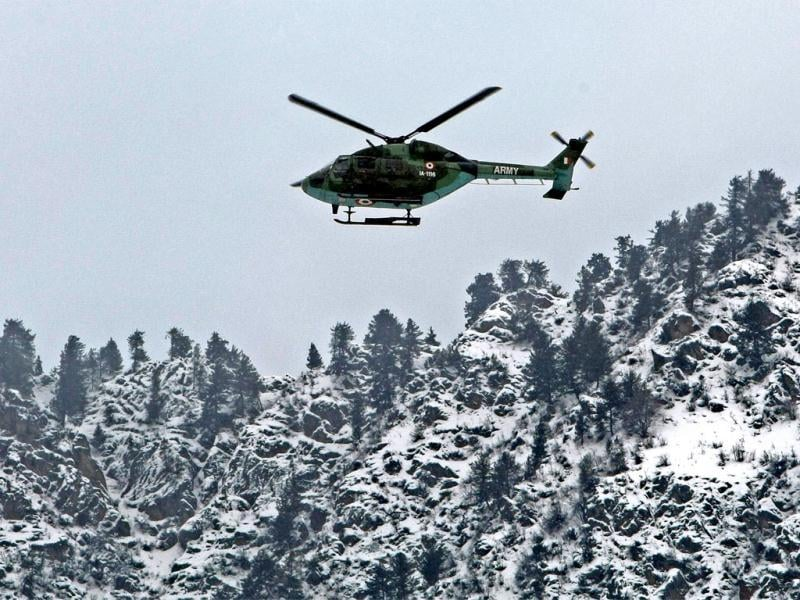 An army helicopter, on a rescue mission, near Gund in Ganderbal district on Thursday. Sixteen soldiers were killed, 4 injured and three more are missing after avalanches buried military camps in Sonamarg and Ganderbal areas. PTI Photo by S Irfan
