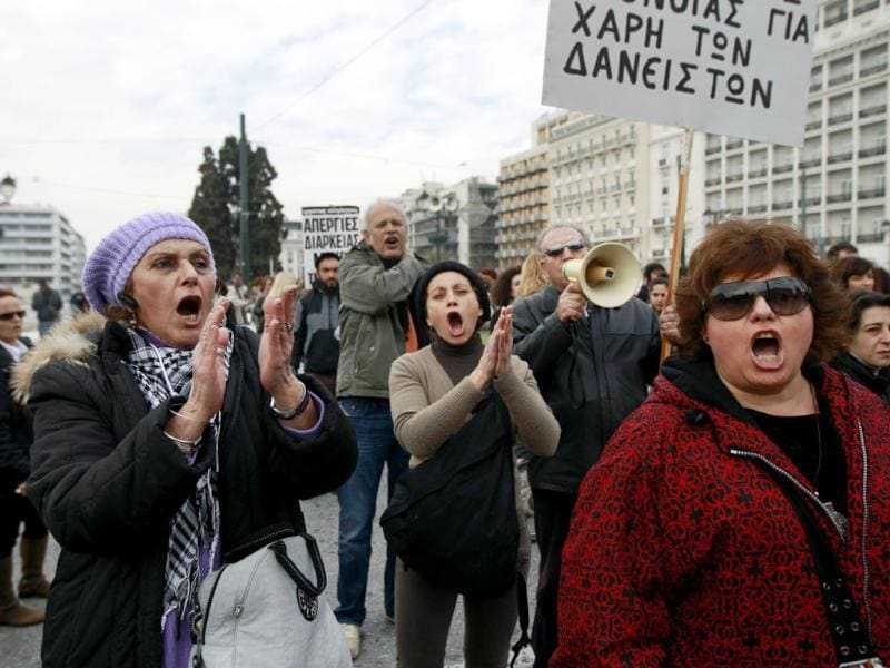 Health workers shout slogans during an anti-austerity rally in front of the parliament in Athens. Doctors and health workers joined the wave of public anger on Thursday, launching a 24-hour strike over pay cuts and calling a protest outside the Health Ministry. REUTERS/John Kolesidis