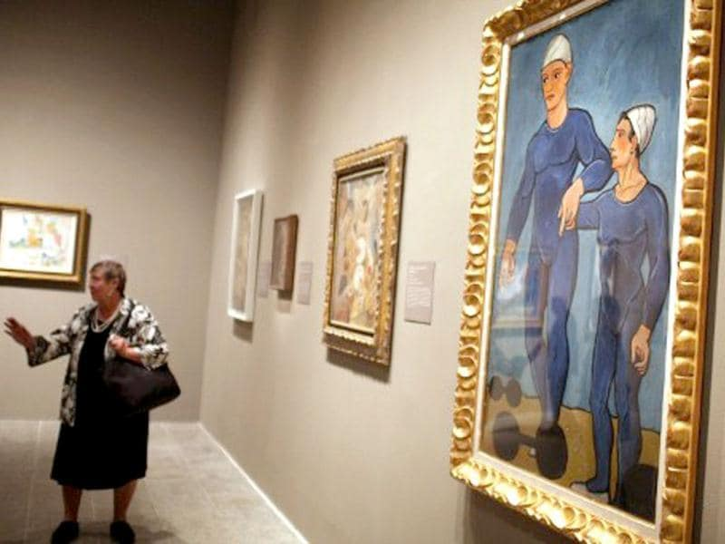 A woman walks through a preview of 'The Steins Collect: Matisse, Picasso, and the Parisian Avant-Garde' at the Metropolitan Museum of Art in New York City. Spencer Platt/Getty Images/AFP