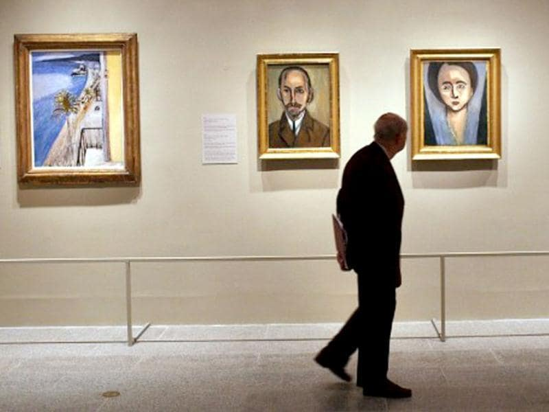 A man walks through a preview of 'The Steins Collect: Matisse, Picasso, and the Parisian Avant-Garde' at the Metropolitan Museum of Art in New York City. Spencer Platt/Getty Images/AFP