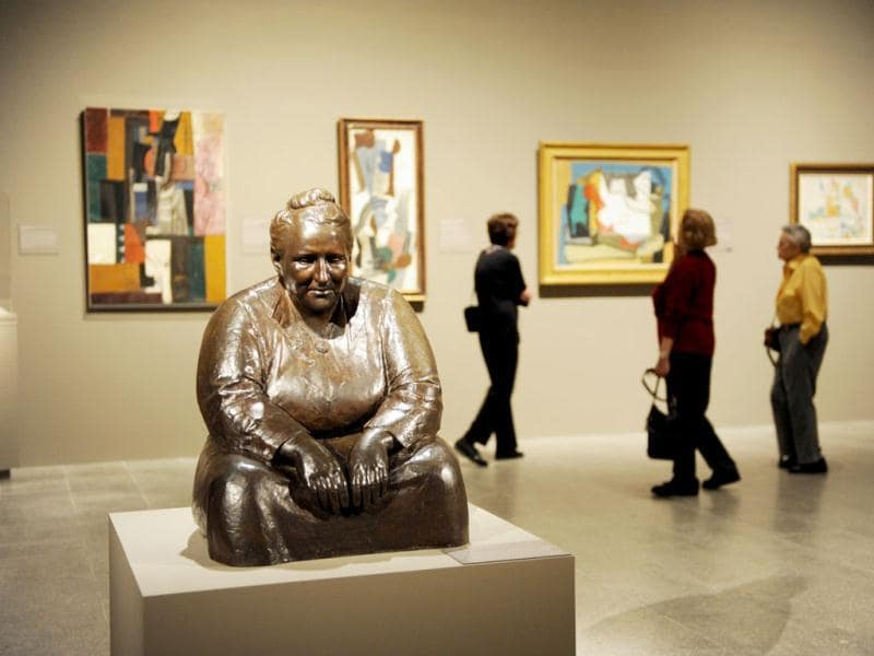 A bronze scupture of Gertude Stein by Jo Davidson in a room with paintings by Pablo Picasso (rear) during a preview of 'The Steins Collect: Matisse, Picasso, and the Parisian Avant-Garde' at the Metropolitan Museum of Art in New York. AFP/Stan Honda