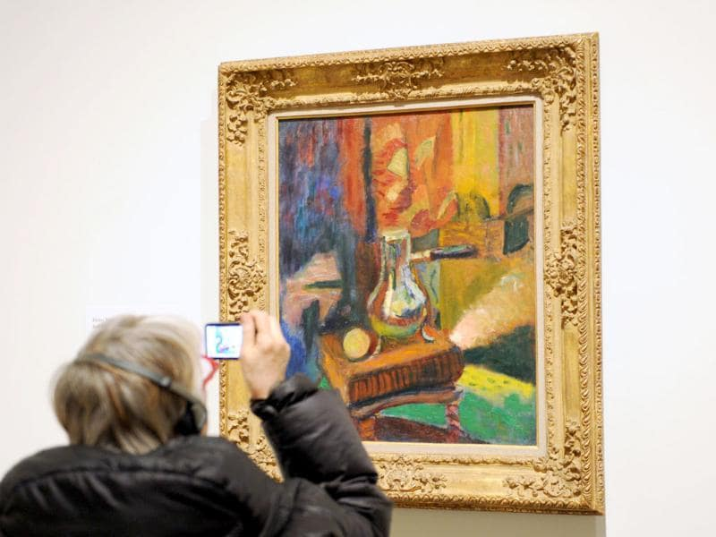 A woman takes a photograph of 'Still Life with Chocolate Pot' 1900-1902 by Henri Matisse during a preview of 'The Steins Collect: Matisse, Picasso, and the Parisian Avant-Garde' at the Metropolitan Museum of Art in New York. AFP/Stan Honda