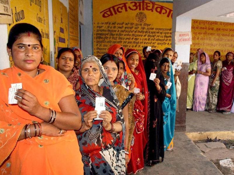 Voters standing in a queue to cast their votes during the fifth phase of UP assembly polls in Jhansi . PTI Photo