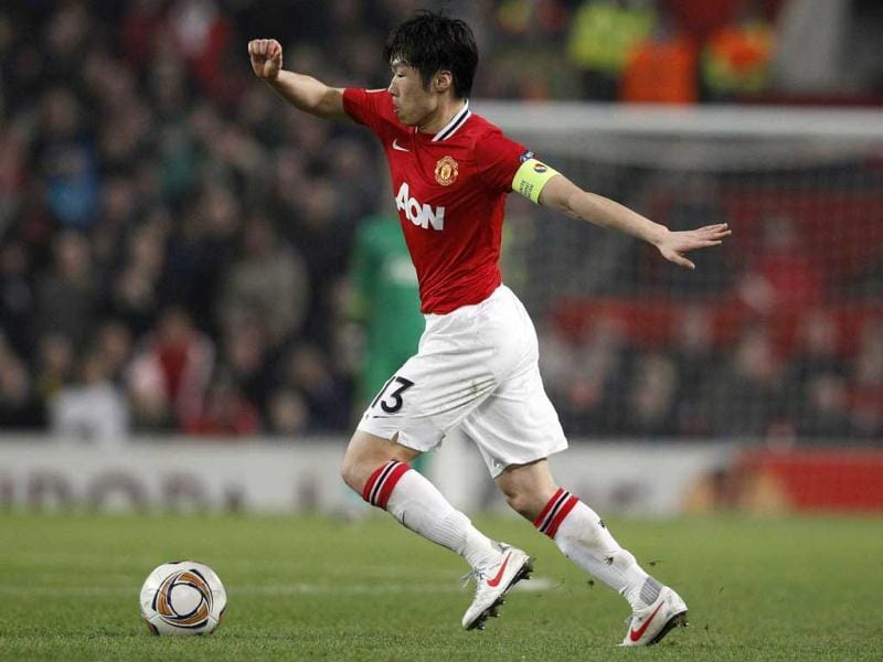 Manchester United's Park Ji-Sung runs with the ball during their Europa League second leg round of 32 soccer match against Ajax at Old Trafford in Manchester, northern England. (Reuters)