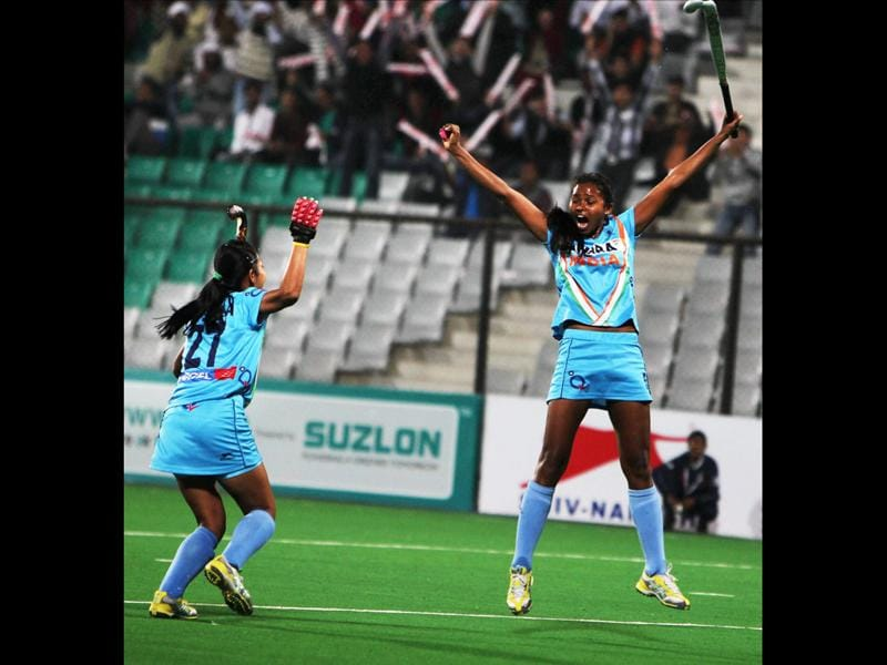 Indian women's hockey captain Asunta Lakra (R) celebrates with a teammate after scoring a goal against South Africa during their Olympic qualifier (women's) hockey match in New Delhi. PTI Photo/Vijay Verma