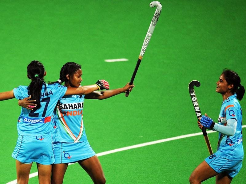 Sushila Chanu Pukhrambam (L) and Vandana Katariya (R) of India's womens hockey team celebrate with captain Asunta Lakra after a goal during the women's field hockey match between India and South Africa. AFP PHOTO/Indranil Mukherjee