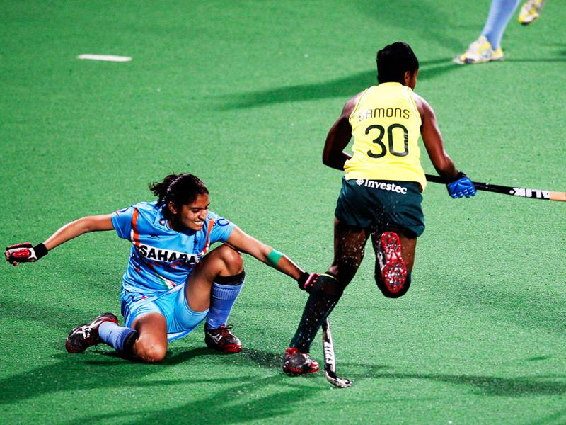 Women's hockey team player Kirandeep Kaur taackles outh Africa's Sulette Damons during their women's field hockey Olympic qualifier in New Delhi. AP Photo/Saurabh Das