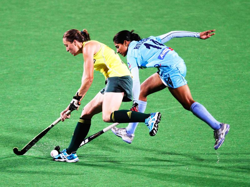 Hockey player Ritu Rani (R) fights for the ball with South Africa's Kathleen Taylor during their London 2012 Olympic Games women's field hockey qualifying match in New Delhi. REUTERS/B Mathur