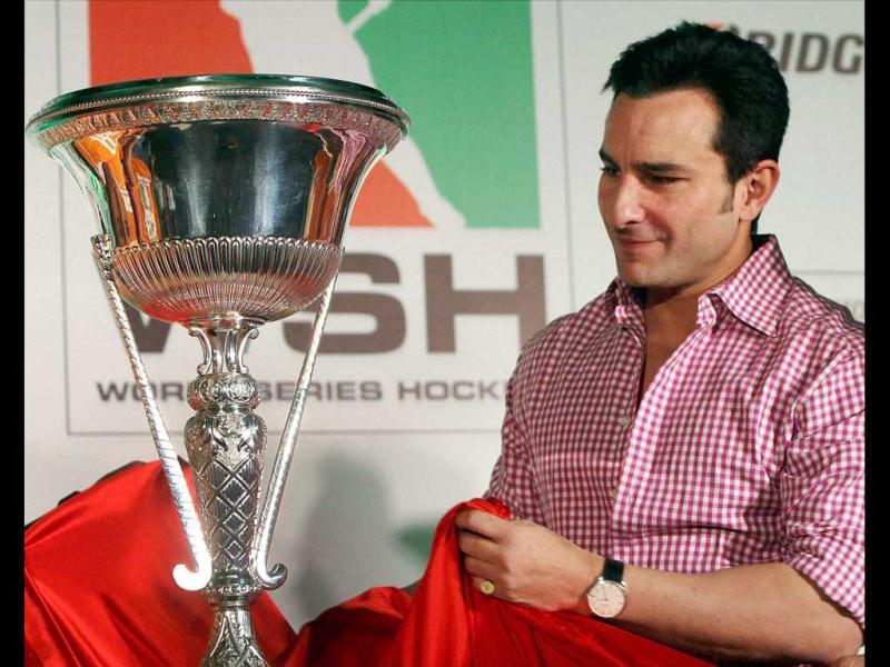 Saif Ali Khan poses with the trophy at the the World Series Hockey press conference on Feb 23 in Mumbai.