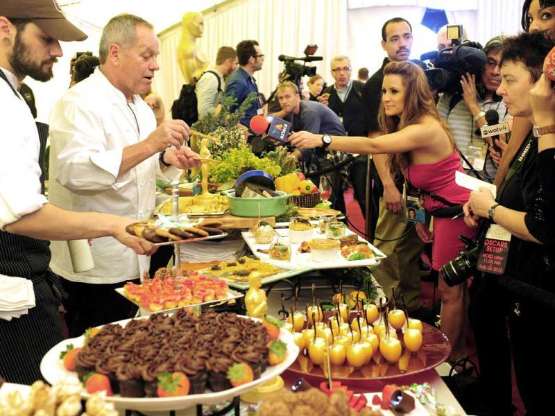 Celebrity chef Wolfgang Puck demonstrates during the food and beverages to be served at the Governor's Ball immediately following the 84th Annual Academy Awards.